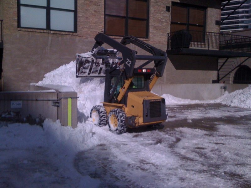 Snow Plow Against Building
